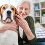 happy-senior-woman-hugging-dog.jpg